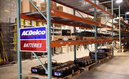 2nd image of warehouse interior showing racks storing ACDelco batteries